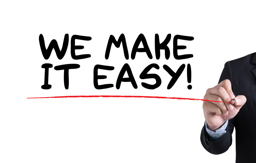 WE MAKE IT EASY!  Businessman hand writing with black marker on white background
